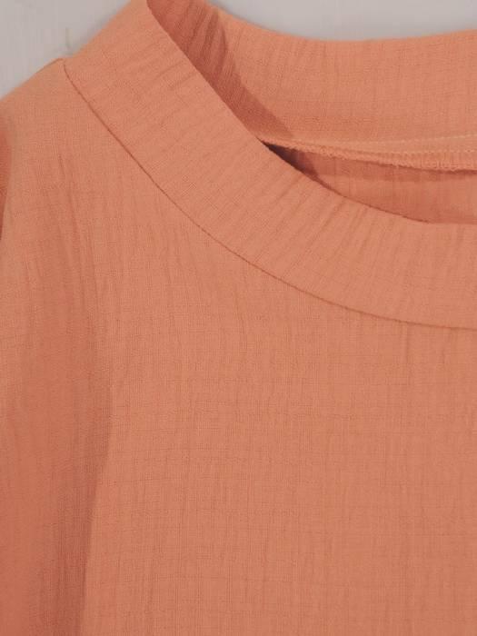 Ozdobna sukienka wizytowa, kreacja z dzianiny w kolorze morelowym 28253